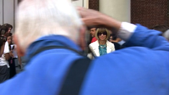 "Bill Cunningham shooting Anna Wintour as she enters a fashion show during Fashion Week in New York City, from the feature-length documentary, ""Bill Cunningham New York,"" ( 2010),  directed by Richard Press and produced by Philip Gefter.  TO BE USED ONLY WITH PRESS AND PROMOTIONAL COVERAGE OF THE FILM. NOT TO BE USED FOR ANY OTHER PURPOSE WITHOUT PERMISSION FROM THE FILMMAKERS credit: First Thought Films Contact Philip Gefter: philipgefter@gmail.com"